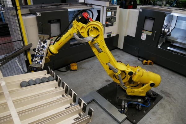 Robotic CNC machining center