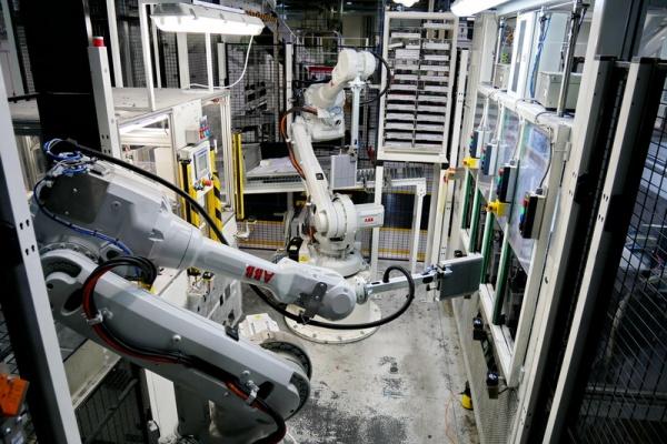 Leak testing robotic cell